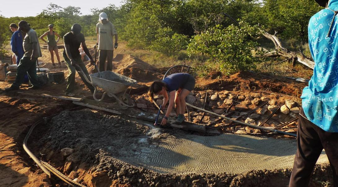 Projects Abroad Bushveld Conservation volunteers work hard to build a waterhole at the Wild at Tuli game reserve in Botswana